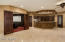 The lower level walkout offers a large game room with kitchenette, bar, and theater room.