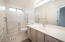 Well cared for master bathroom with a large shower and plenty of counter space.