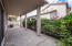 Oversized covered patio with low maintenance landscaping.
