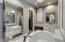 Two walk-in closets, separate sinks, garden tub and walk-in shower