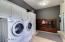 Laundry room with additional storage