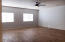 """Extra large 5th bedroom with closet, double door entry can also be a game room; 2-new 50"""" blinds and new wood floorings, new LED fan, freshly painted in cool color; all new hardware on door and closet."""