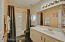 Guest bathroom with Jacuzzi tub...