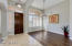 Light, airy entry opens to formal dining room and den.
