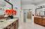 Double sinks, granite counters, oil rubbed bronze fixtures.