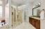 Lovely custom tiled shower with brand new glass door.