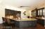 Eat-in kitchen with 18 ft granite breakfast bar.