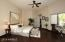 Master suite with hardwood floors.