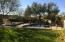 LUSH backyard with pool spa, SWING ROPE, outdoor kitchen and putting green .