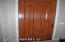 Elegant, solid wood front door at entrance.