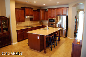 Amazing gourmet kitchen! Roomy, large center island/breakfast bar, walk-in pantry, upgraded granite and maple cabinetry, quiet dishwasher... all appliances stay!!