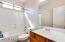 This guest bath offers a full bath with a single sink and is located on the first floor.