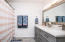 Hall bath with new vanity, toilet, hardware, flooring, paint