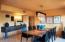 Formal dining room has custom white maple built in buffet