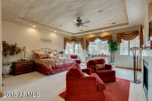 Huge master bedroom with custom lighting and ceiling, beautiful views and a gas fireplace!