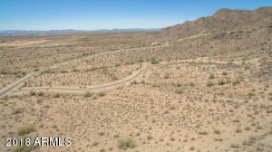 Backing to the beautiful White Tank Mountains, this mountainside lot offers rear views of the mountains and front views of city lights. The beautiful Crescent park. The home site is 1.60 acres in Verrado. Private, secluded and adjacent to the mountain this homesite is within close proximity to all Verrado amenities including new Verrado swim park, schools, golf course, shopping, dining, hiking and biking trails.
