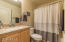 Additional bath with upgraded counter and cabinets