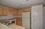 Kitchen has lots of beautiful cabinetry, loads of counterspace and a pantry