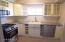 All stainless appliances, trashcan cabinet to right of dishwasher
