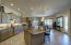 Kitchen offers a calming color palette, under cabinet lighting, and upgraded pendant lighting.