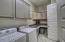 Laundry room offers private entrance to master retreat as well as second entrance near other bedrooms.
