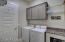 Laundry Room offers built in cabinets and large countertop.