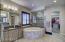 Master Bedroom has his/her vanities, and custom tiled large walk-in shower