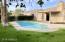 Backyard. Pool and grass.