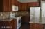 Maple cabinets and new stone backsplash.