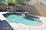 Pebble tec pool features infloor cleaning system and custom water fountain.