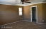 Master bedroom has two separate closets and crown molding. Custom suade textured paint.