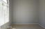 The master suite is split from the 2nd bedroom on opposite sides of the living room and is obscured by mature trees.