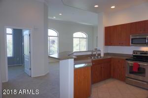 This corner unit has walls of windows & soaring ceilings.