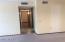 Hallway leading to bedrooms. Laminate flooring.
