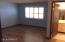 Master bedroom with plantation shutters, laminate flooring, attached bathroom