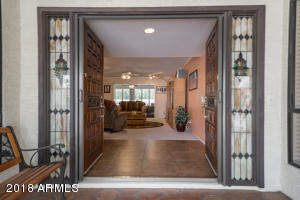 Doub le-Door Entry with Stained Glass and Retractable Shade Screen Door