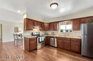 total remodeled kitchen with new cabinets, counters & stainless steel stove, dishwasher & fridge