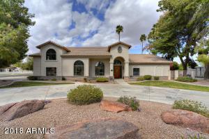 Gorgeous custom home. Circular drive fornt & side entrance 4 car garage. Horse property for sale in Peoria, AZ.