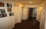 Long, wide hallway to bedrooms