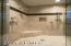 Floor to celing travertine look porcelain tile shower