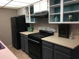 Kitchen cabinets have been painted white,