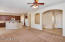 ENTRY FOYER AND KITCHEN FROM GREAT ROOM WITH FRESH DESIGNER PAINT