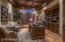 Office with built-in cabinets, copper ceiling and hardwood floors.