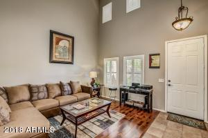 Formal living room with vaulted ceilings