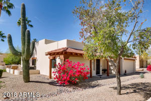 Splash of color and saguaro greet you at this charming terrirorial