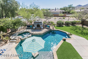 Resort Style Backyard with Spa, Water Features, built in BBQ and an outdoor Fireplace.