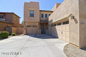 Lovely two story home in Palm Valley with a split three car garage. Come take a look!