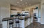 Remodeled kitchen with slab granite counters & stainless appliances!