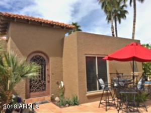 Entry courtyard...great spot to have that morning coffee! Orange trees, roses, and your own huge SAGUARO!