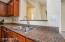 Kitchen overlooks great room area.